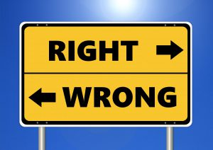 "road sign saying ""right"" and ""wrong"" with arrows pointing left and right"